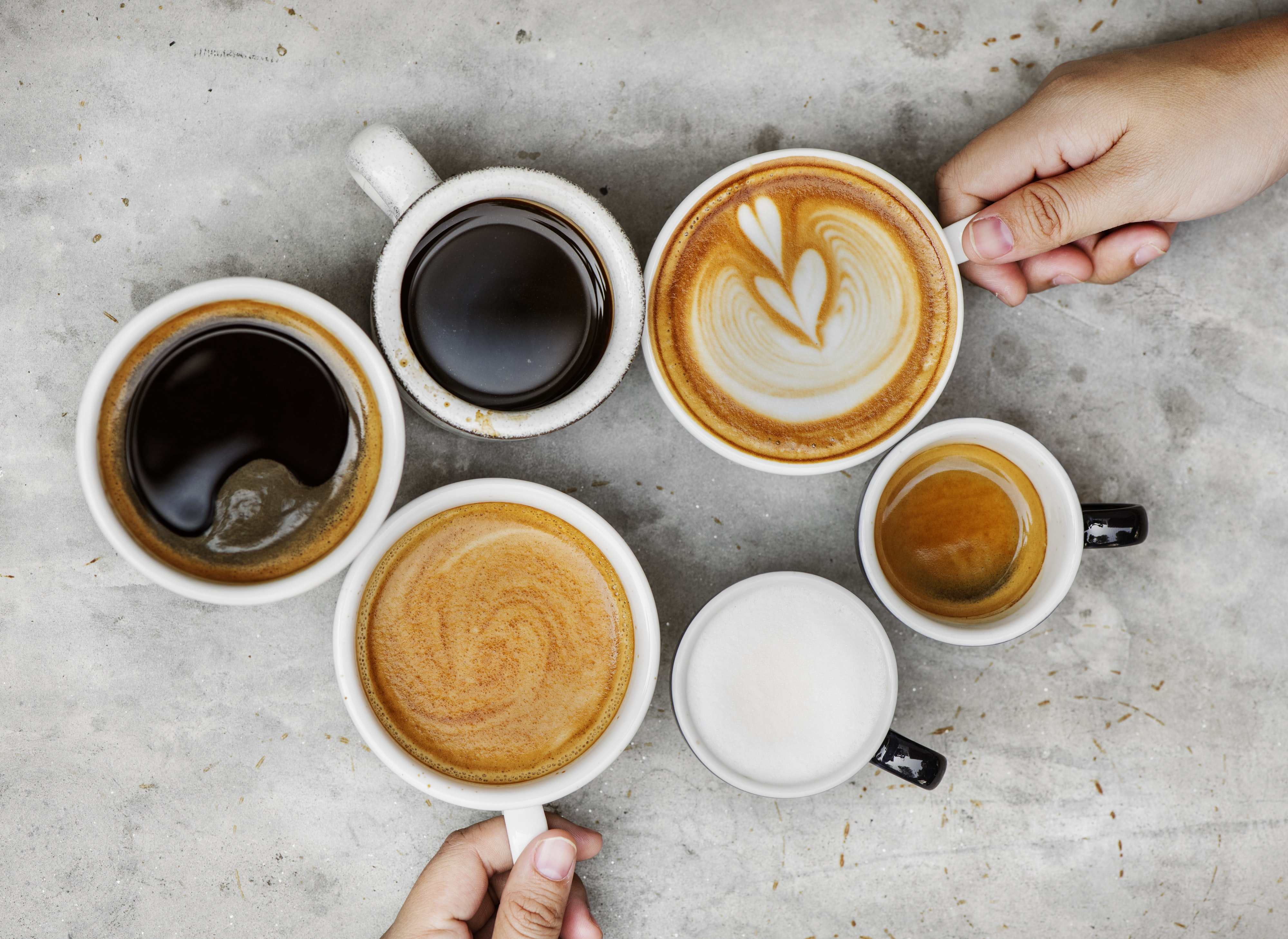 flat-lay photography of latte and coffee