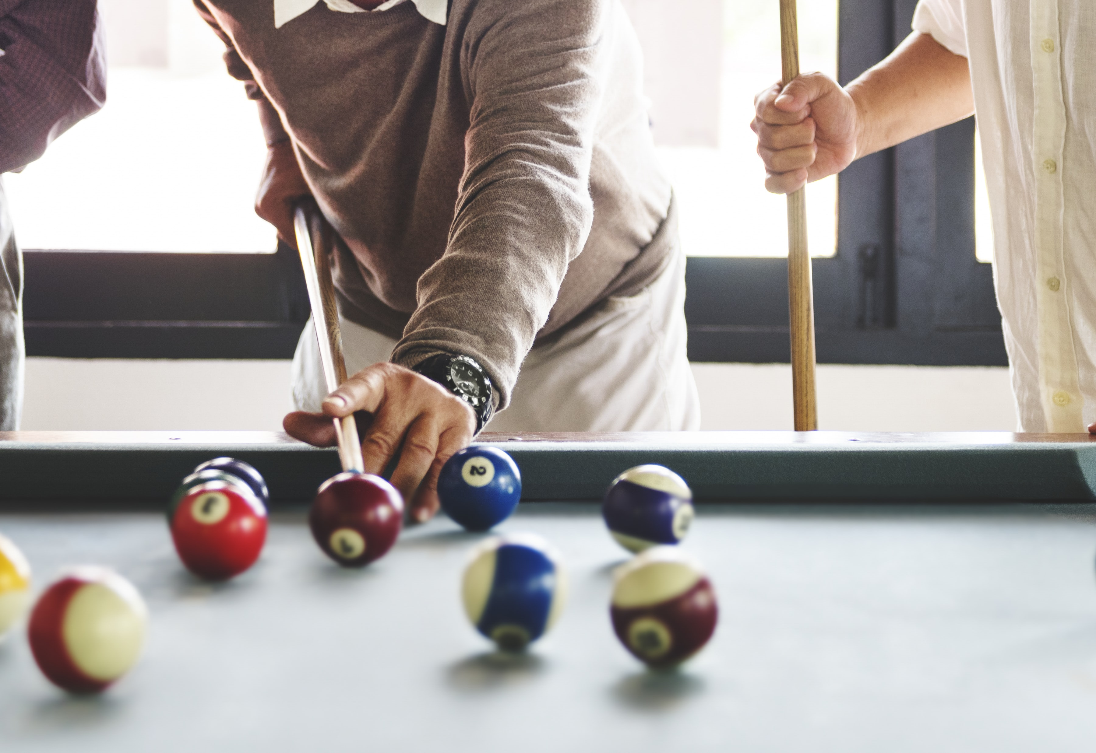 person playing billiards