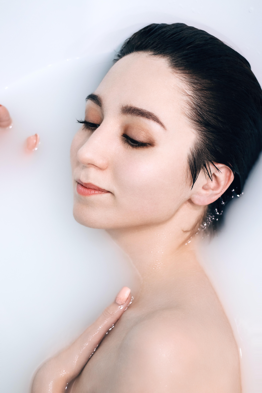 woman bathing in milk