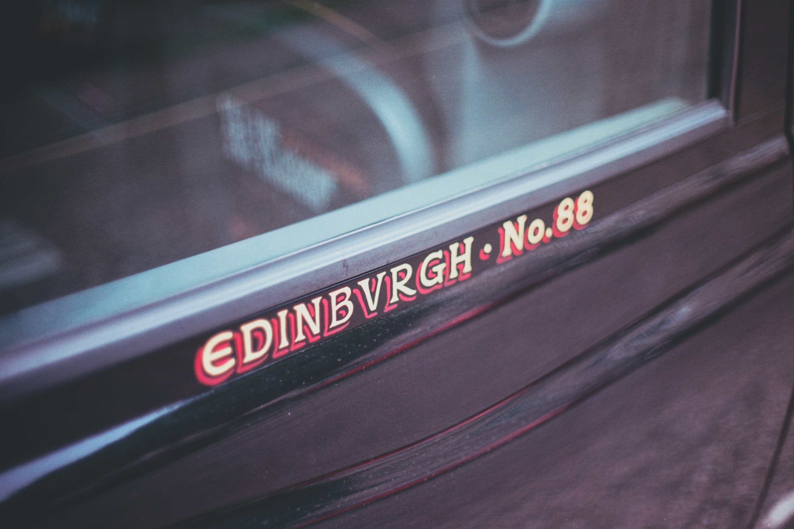 photo of Edinbvrgh No. 88 text on black surface