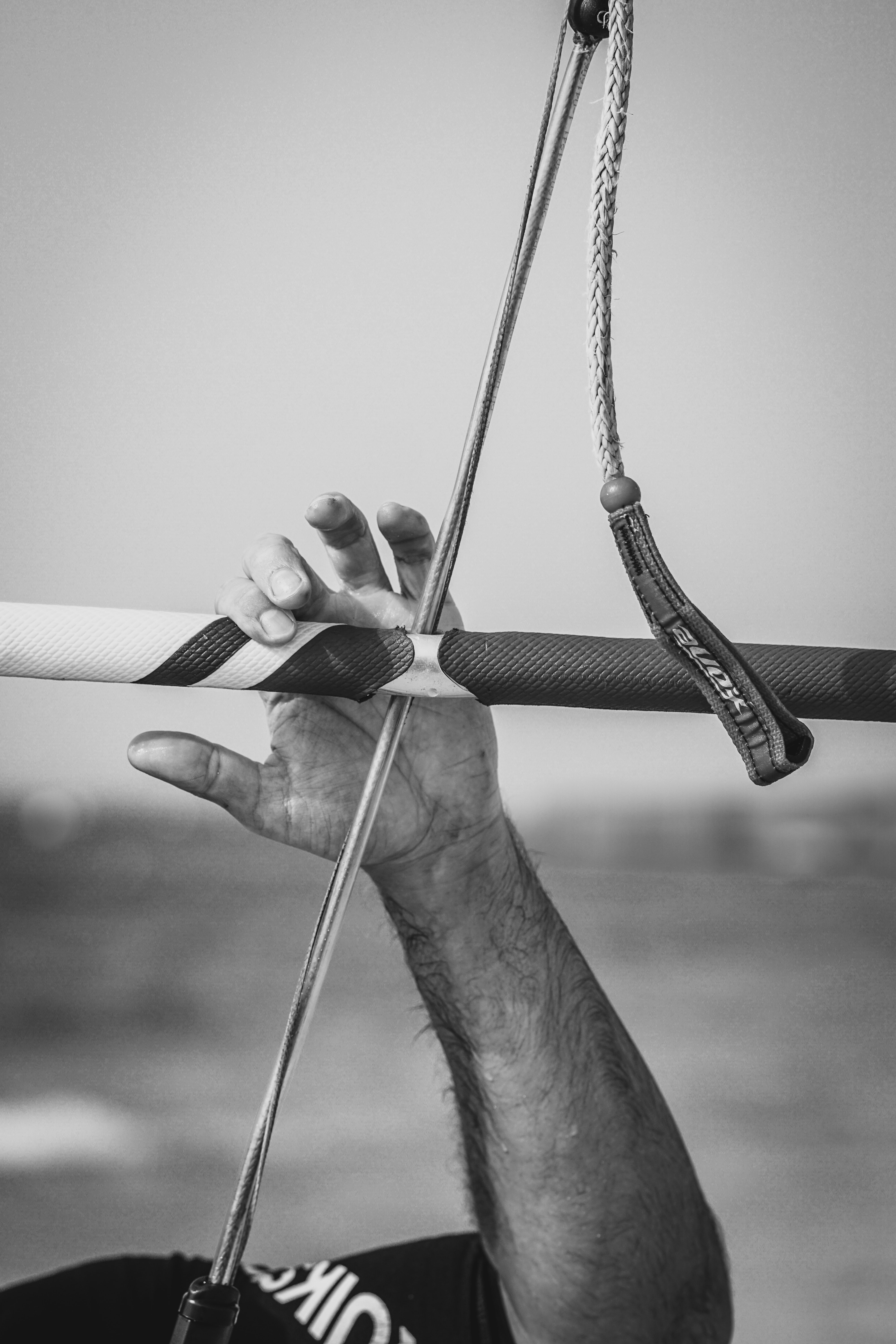 grayscale photo of man holding stick