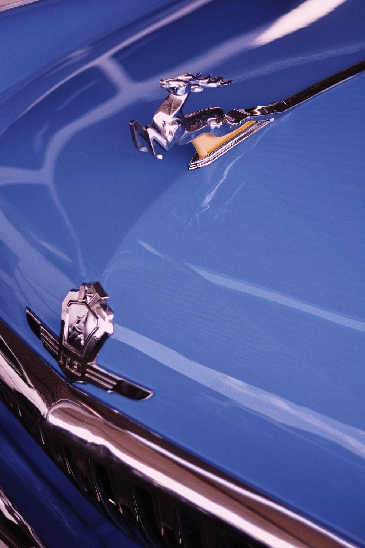 silver car emblem