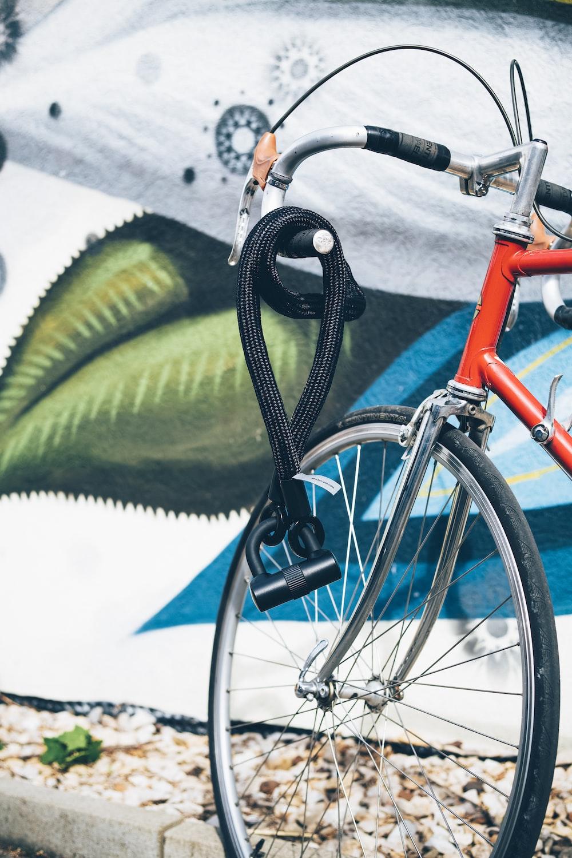 black cable lock on bicycle handlebar
