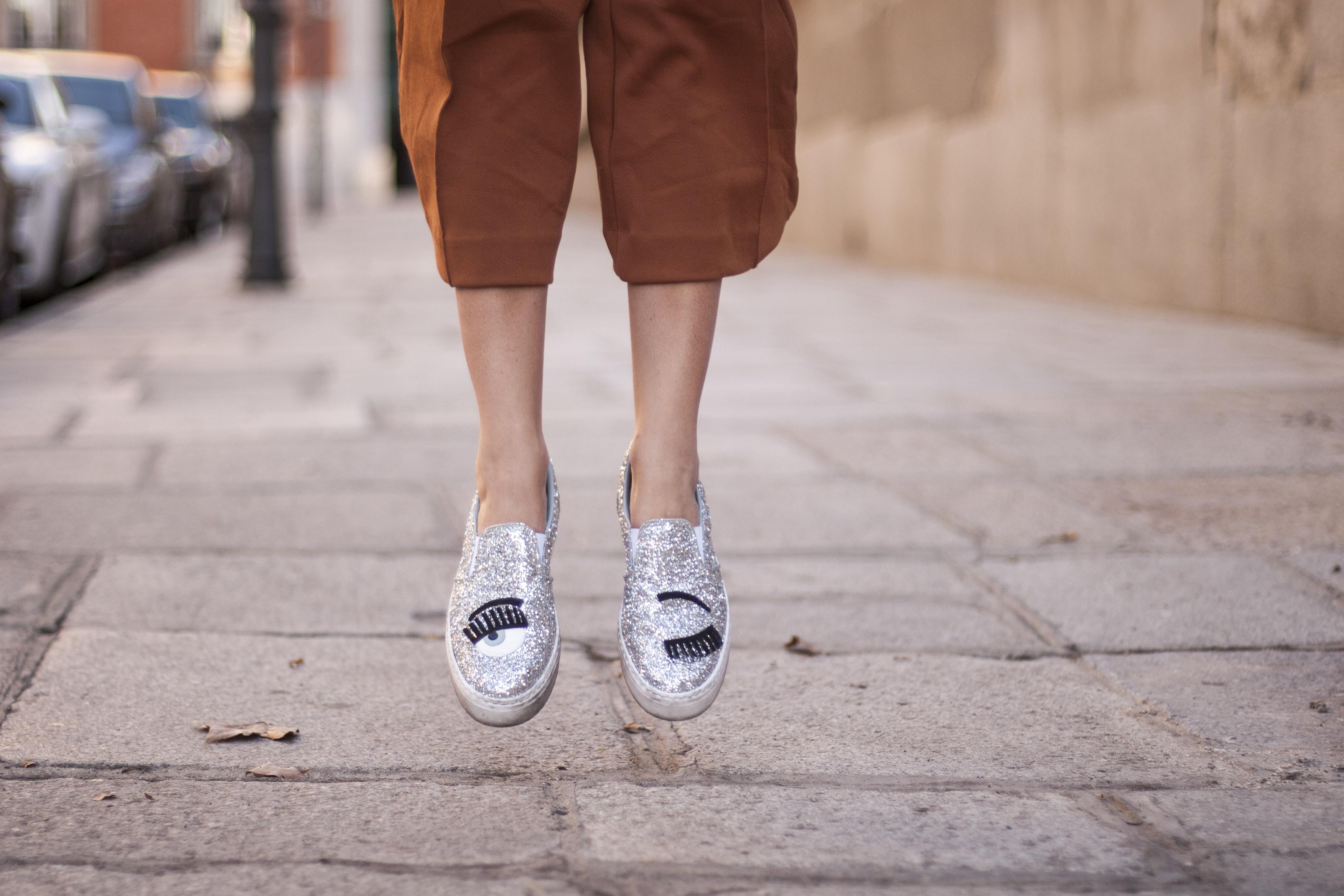person jumping on sidewalk