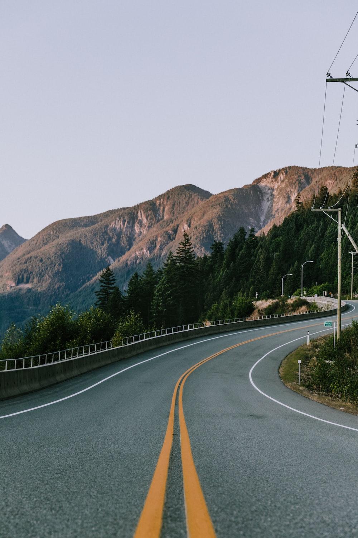 photo of winding road near mountain