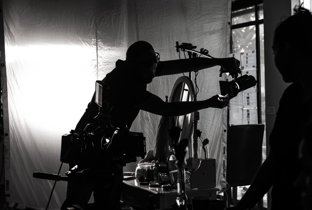 silhouette of person holding camera