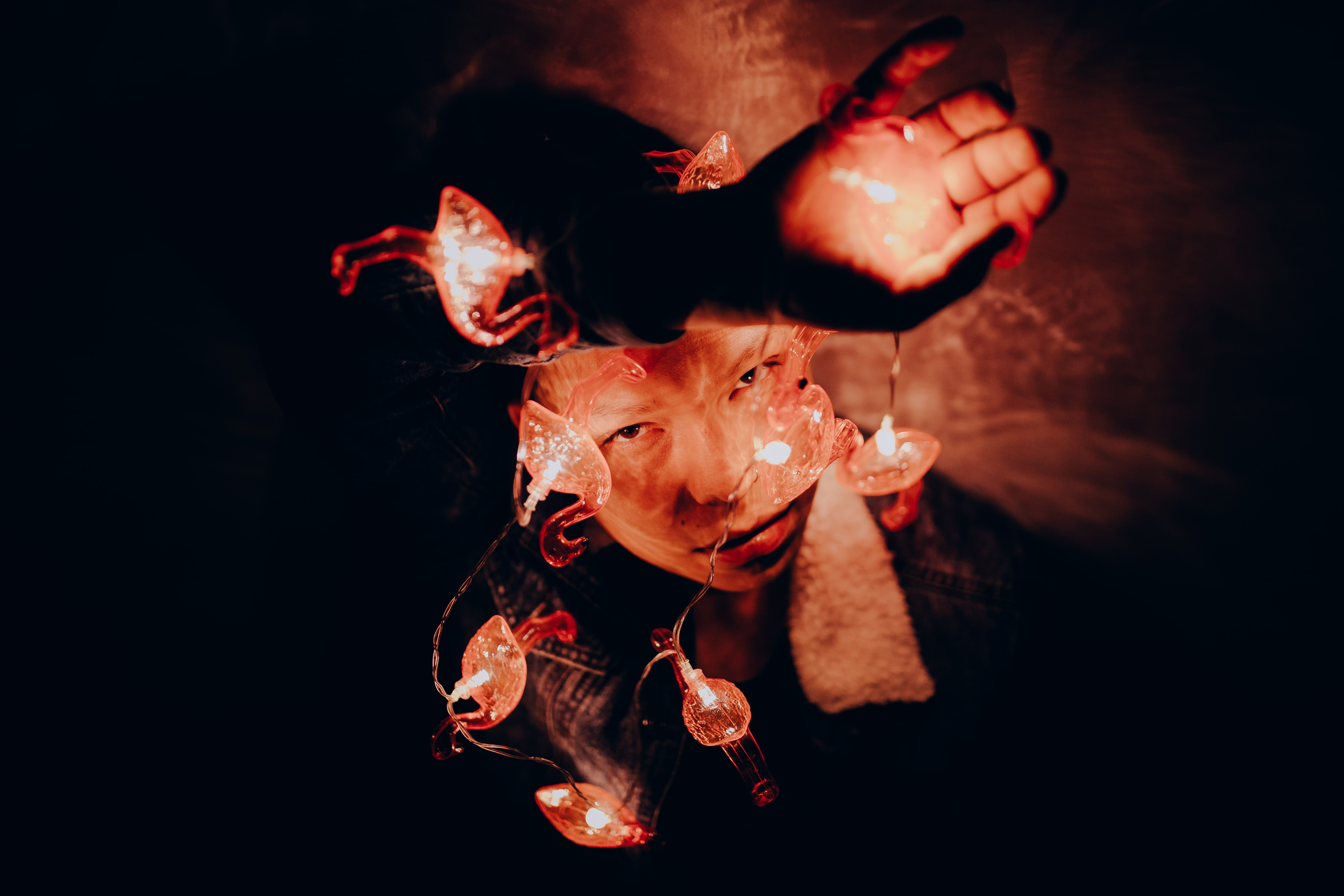 person playing with fire in a dark room