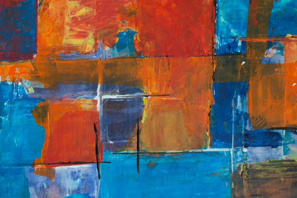 red, orange, and blue abstract painting