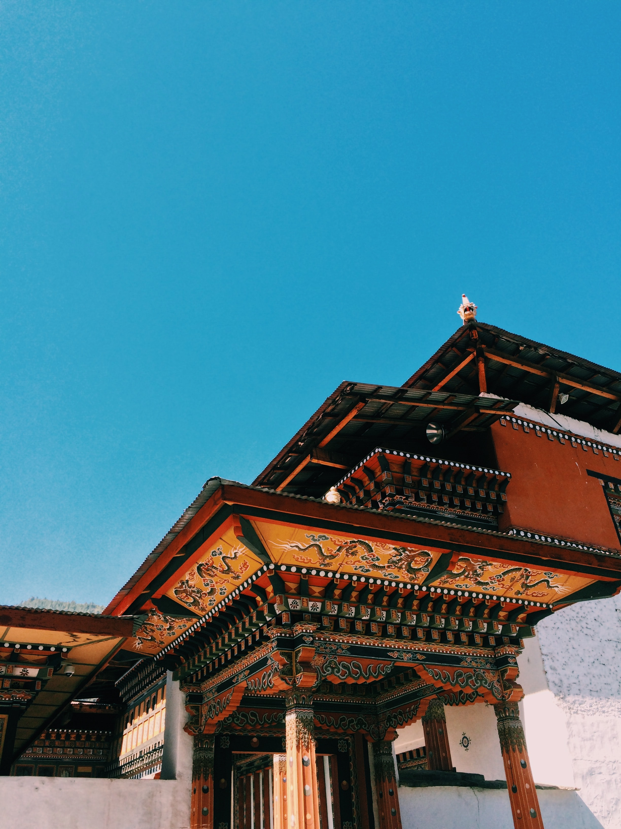 brown and black temple with clear sky