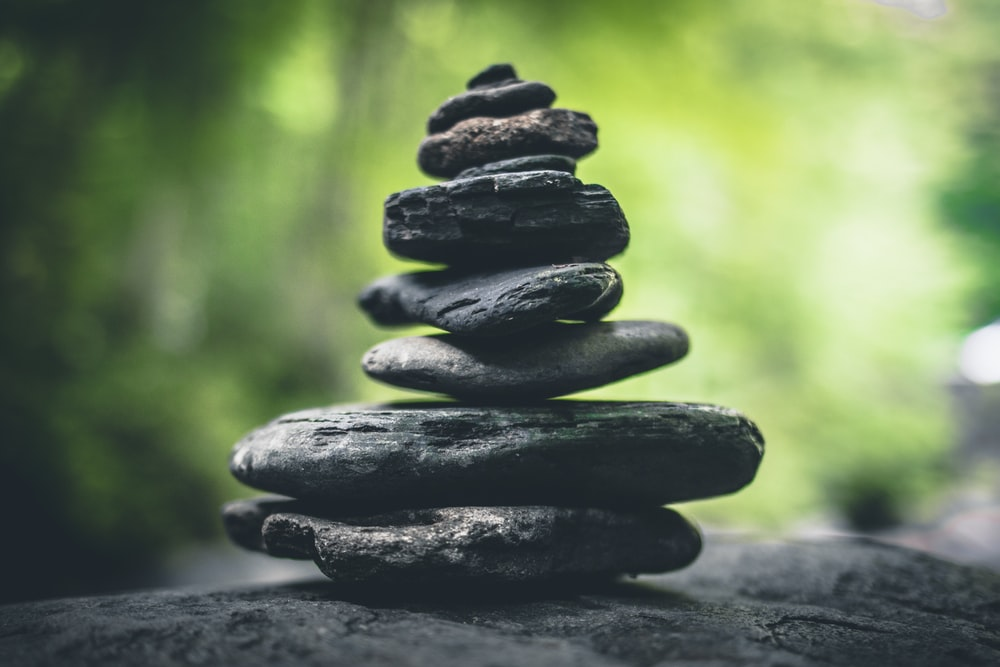 black stacking stones on gray surface