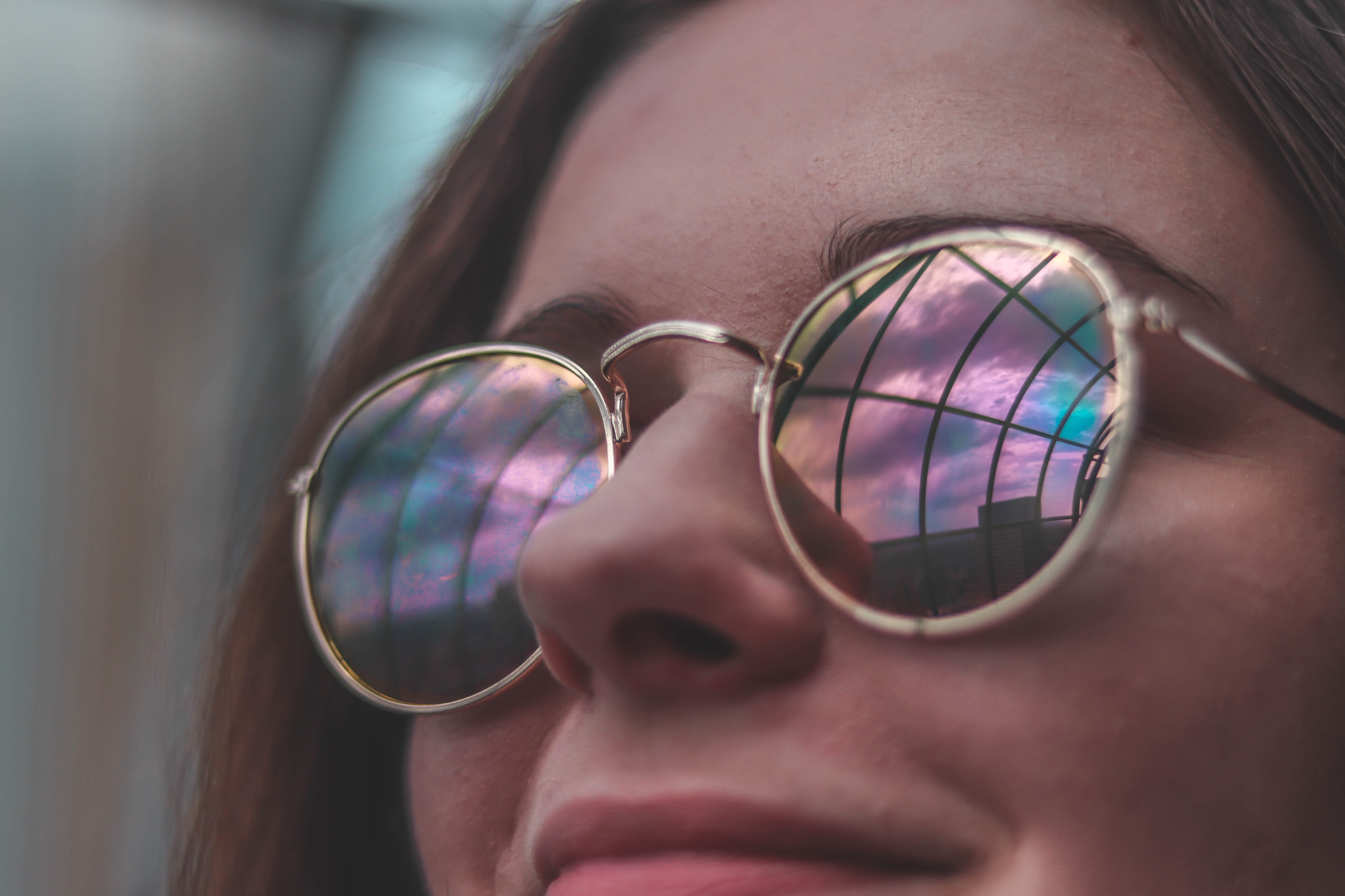 woman wearing sunglasses while smiling