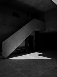 gray stair in grayscale photography