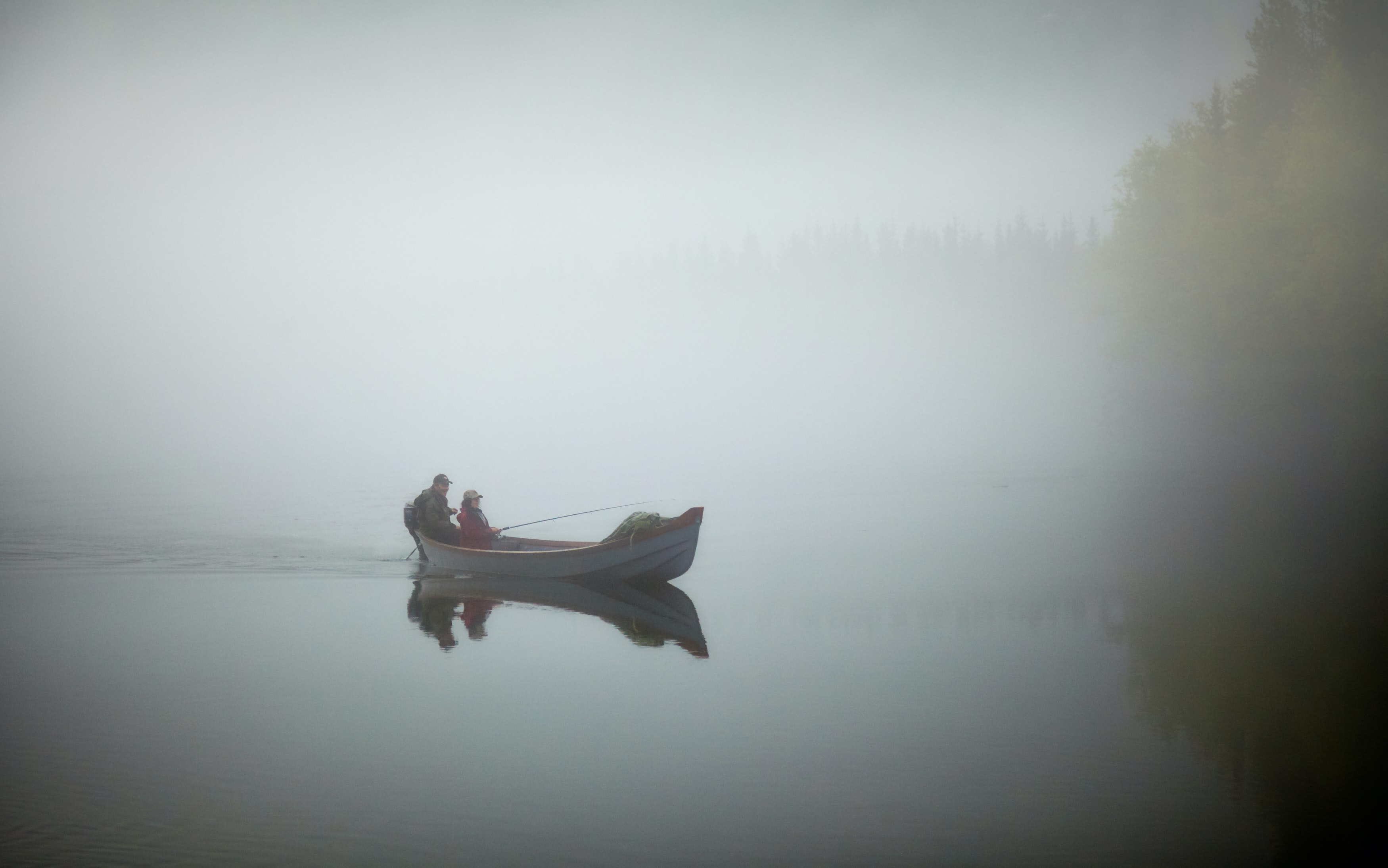 two person fishing on jon boat