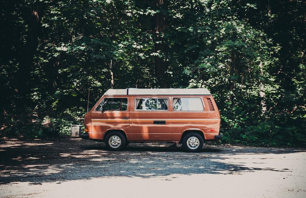 orange van parked near tree