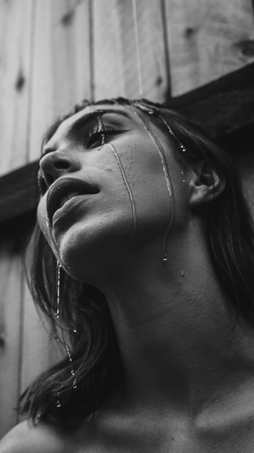 grayscale photo of wet woman