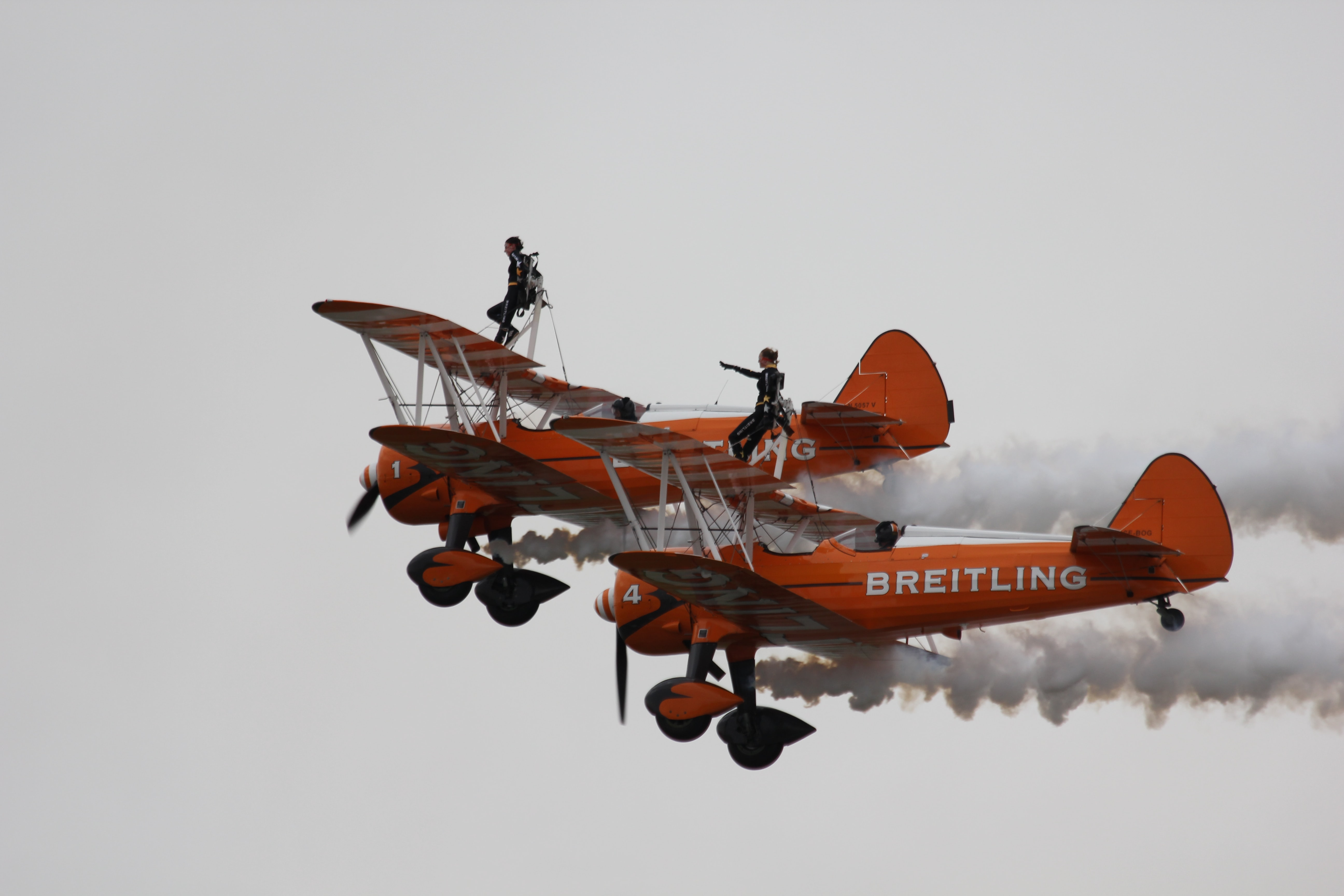 two orange-and-white Breitling airborne