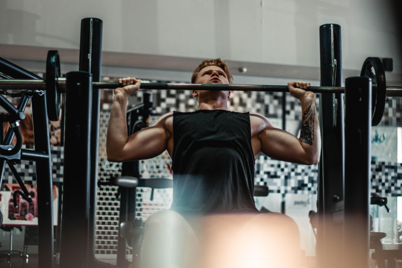 man lifting barbell