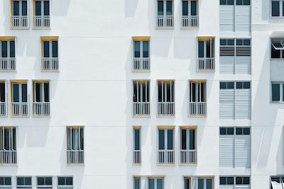 photo of white concrete building simplicity teams background