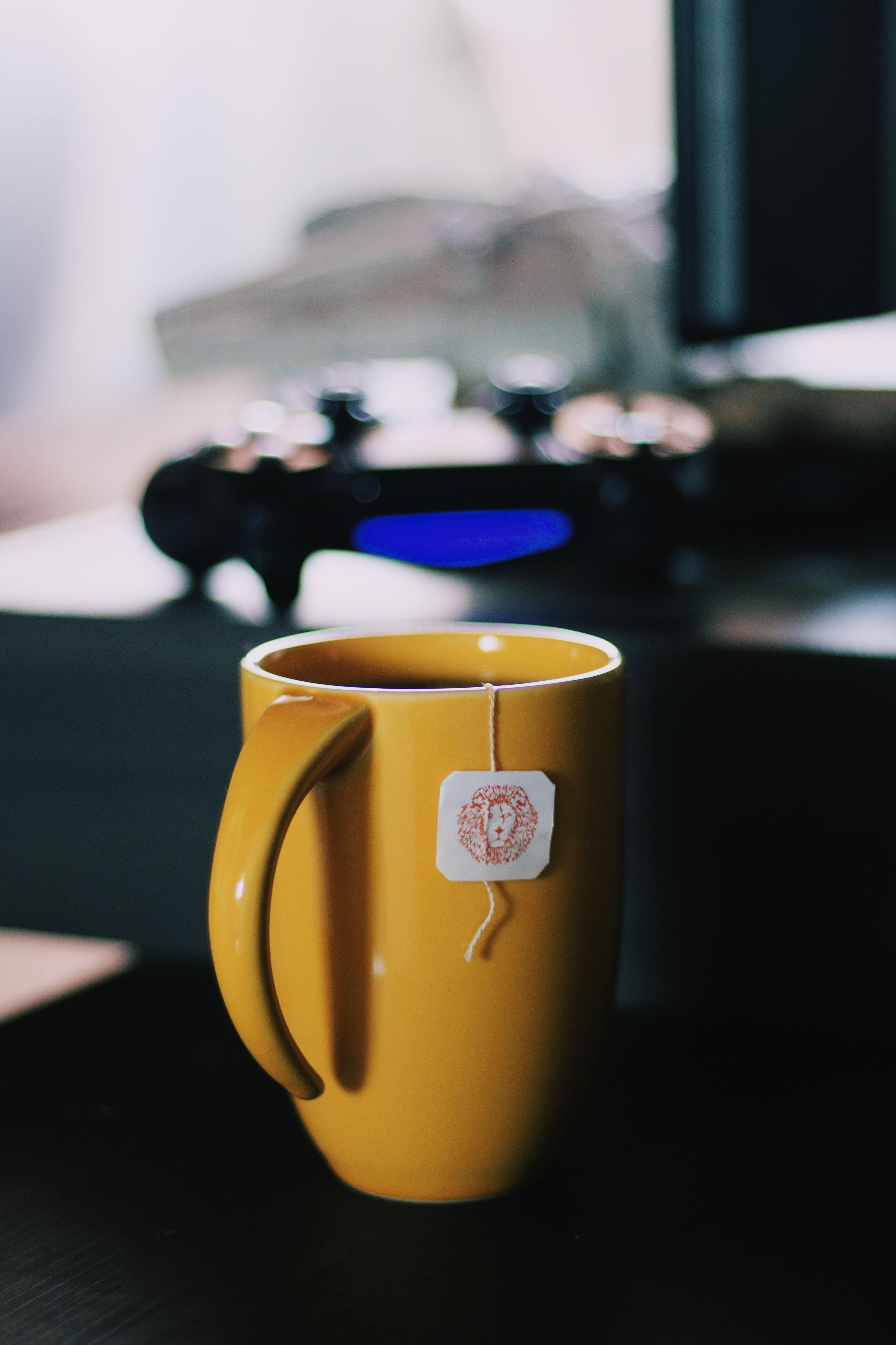selective focus photography of ceramic mug