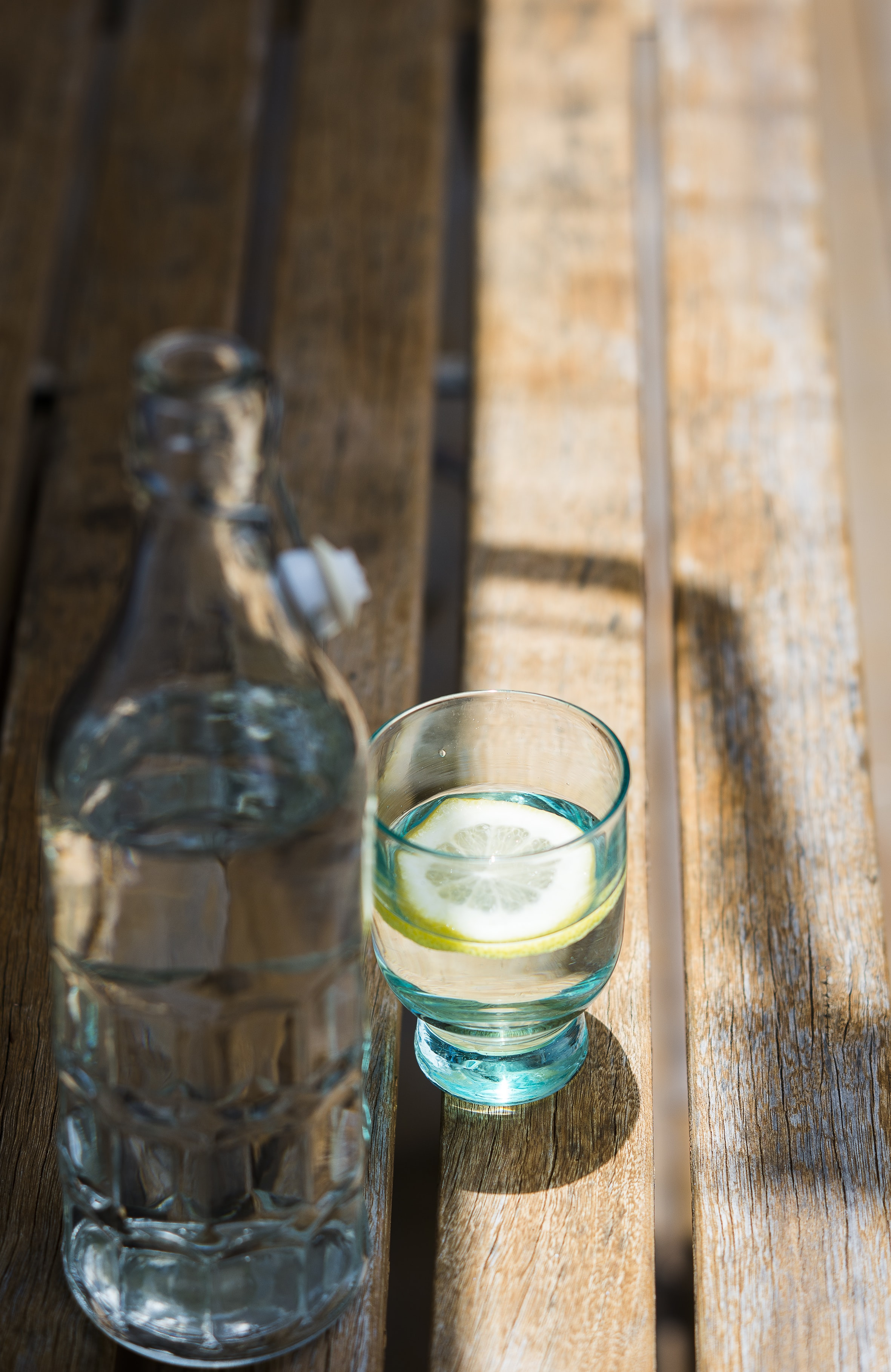liquor in rock glass and bottle