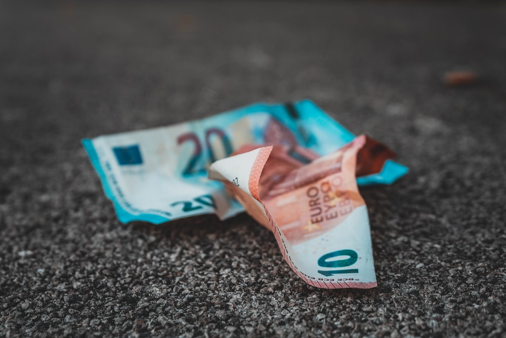10 and 20 banknotes on concrete surface
