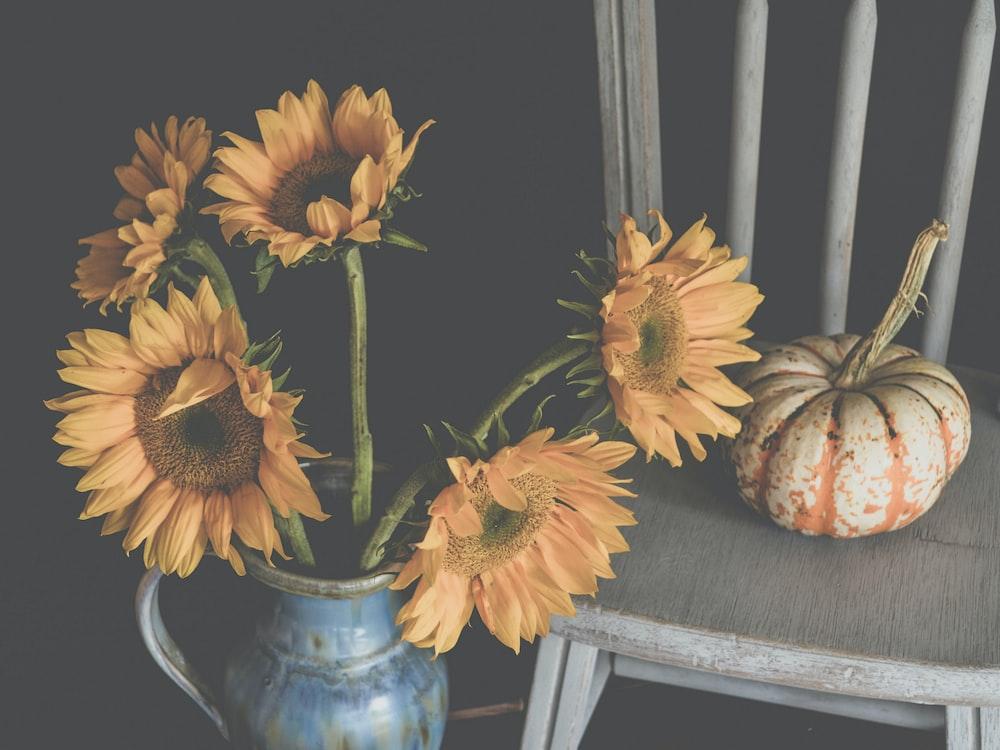 sunflowers on blue ceramic vase