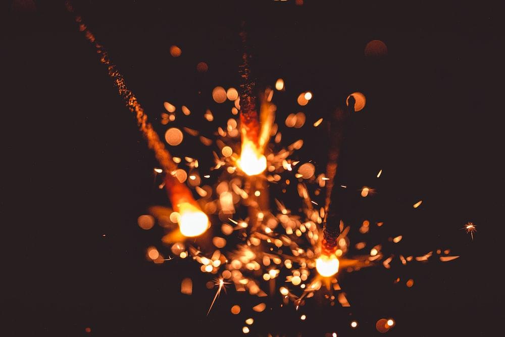 three flaming sparkler sticks