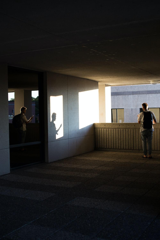 man standing on concrete flooring