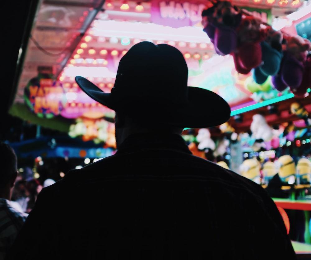 silhouette of man wearing hat