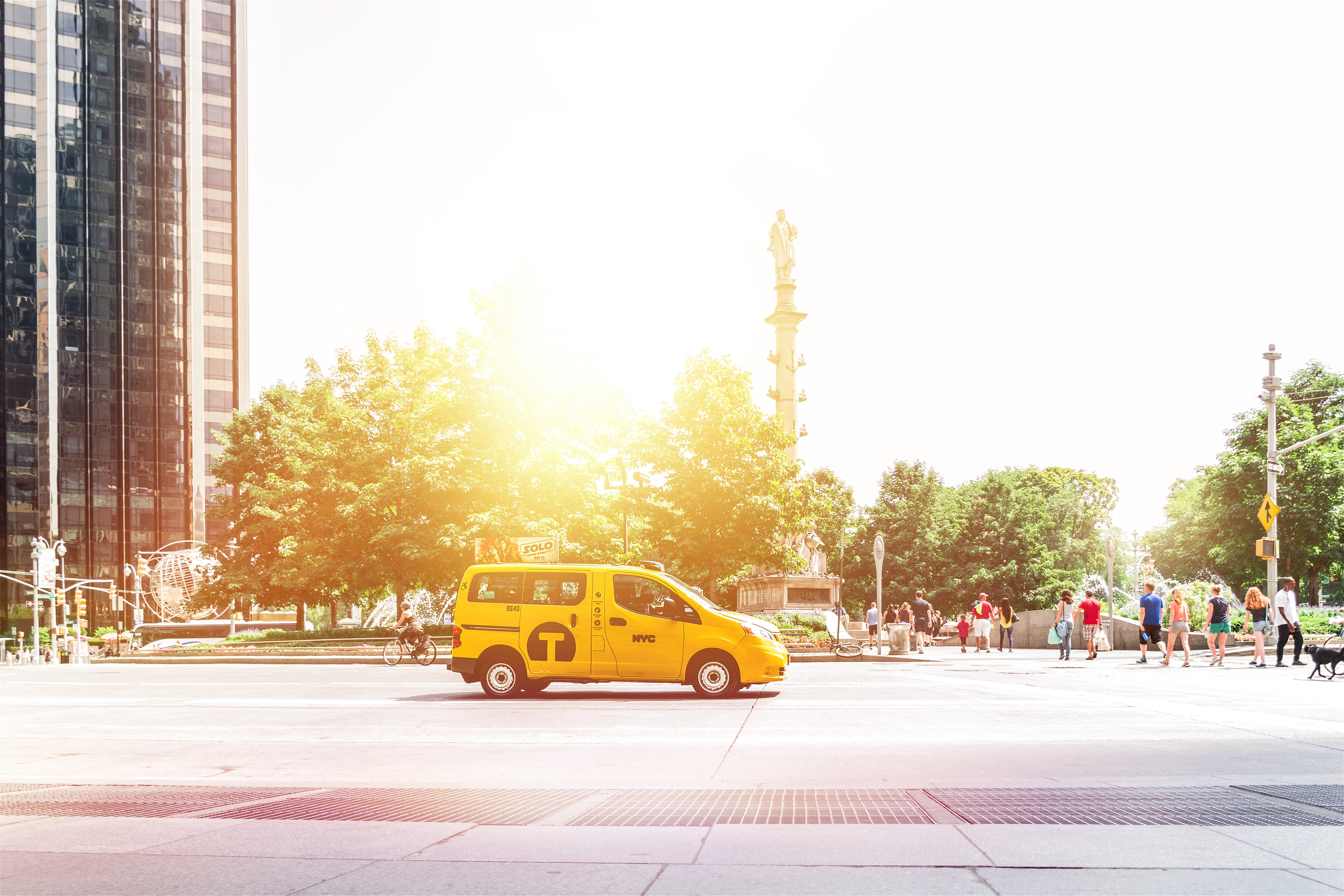 photo of yellow compact van during daytime