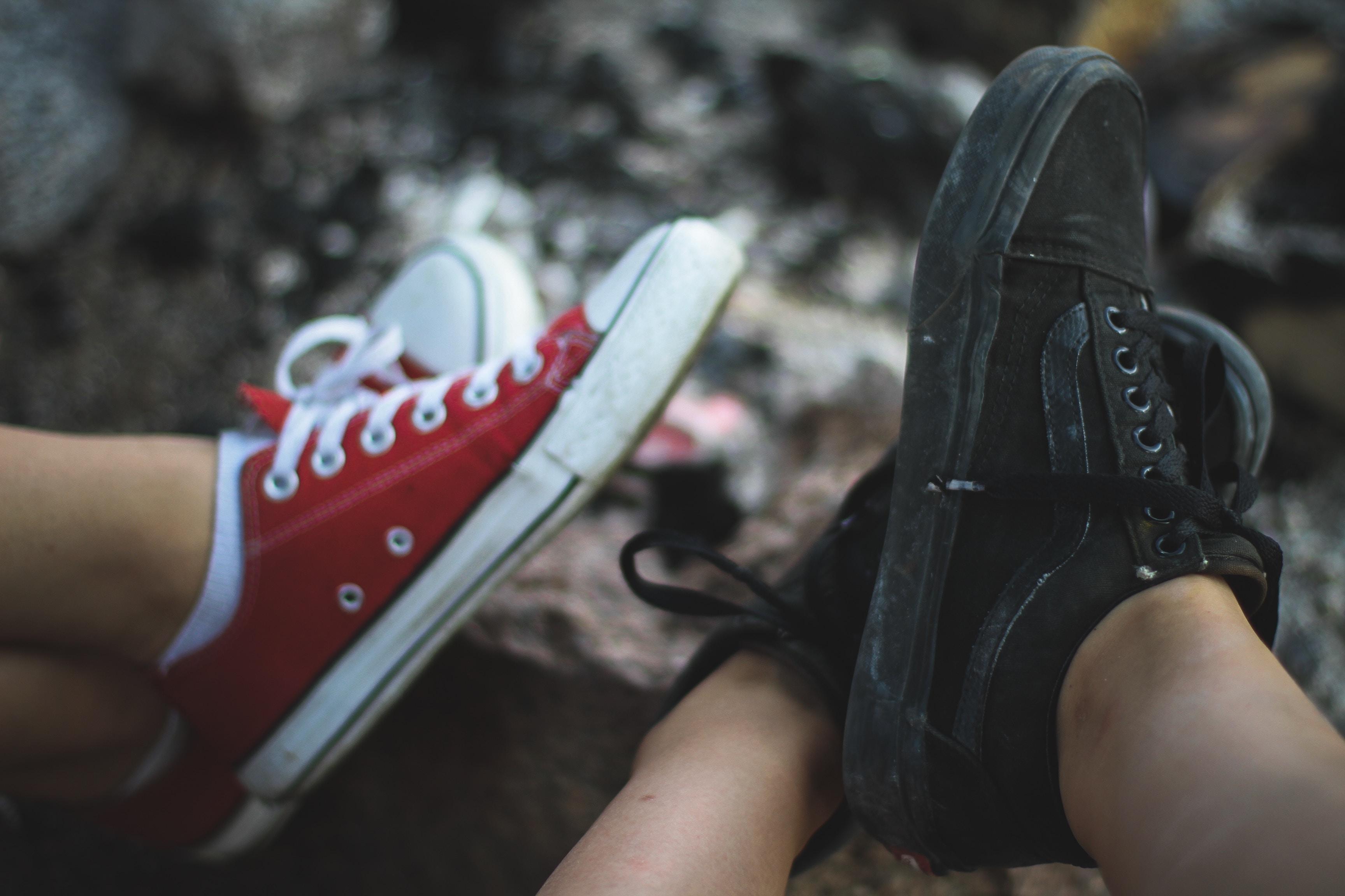person wearing black Vans Old-Skool sneakers