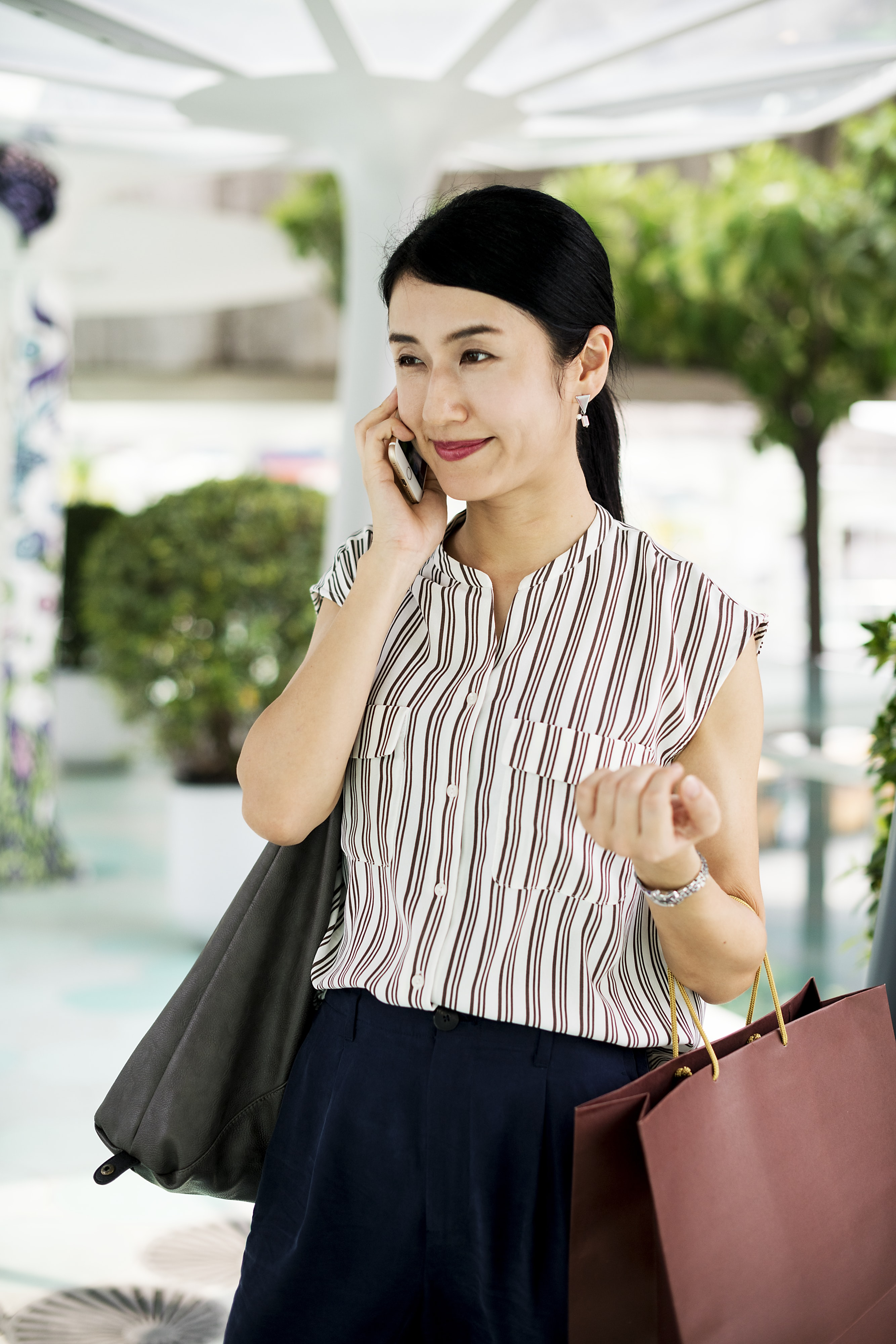 woman taking a call using gold iPhone 6