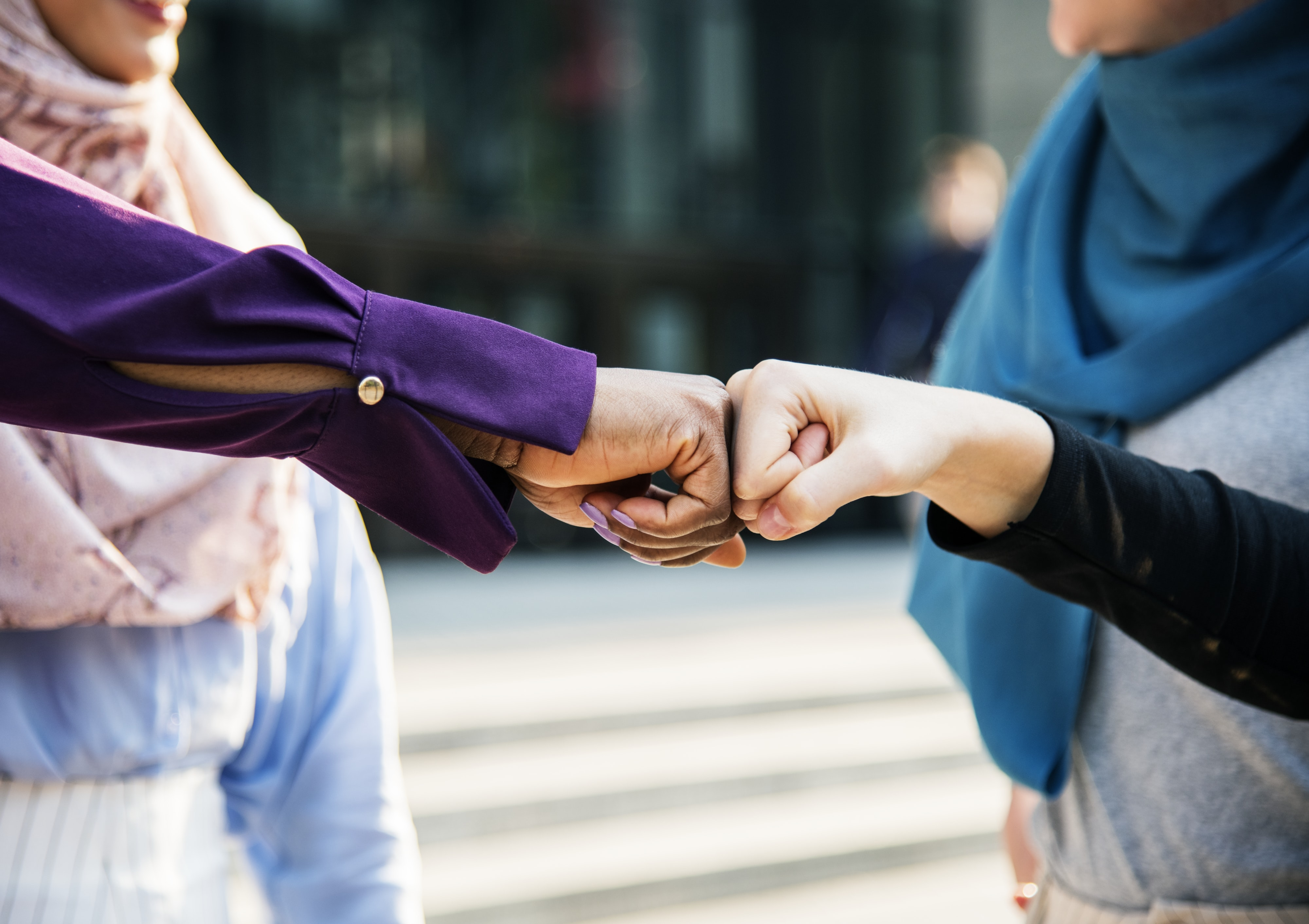 two people doing fist bump