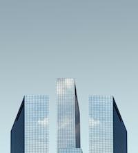 glass buildings under blue sky