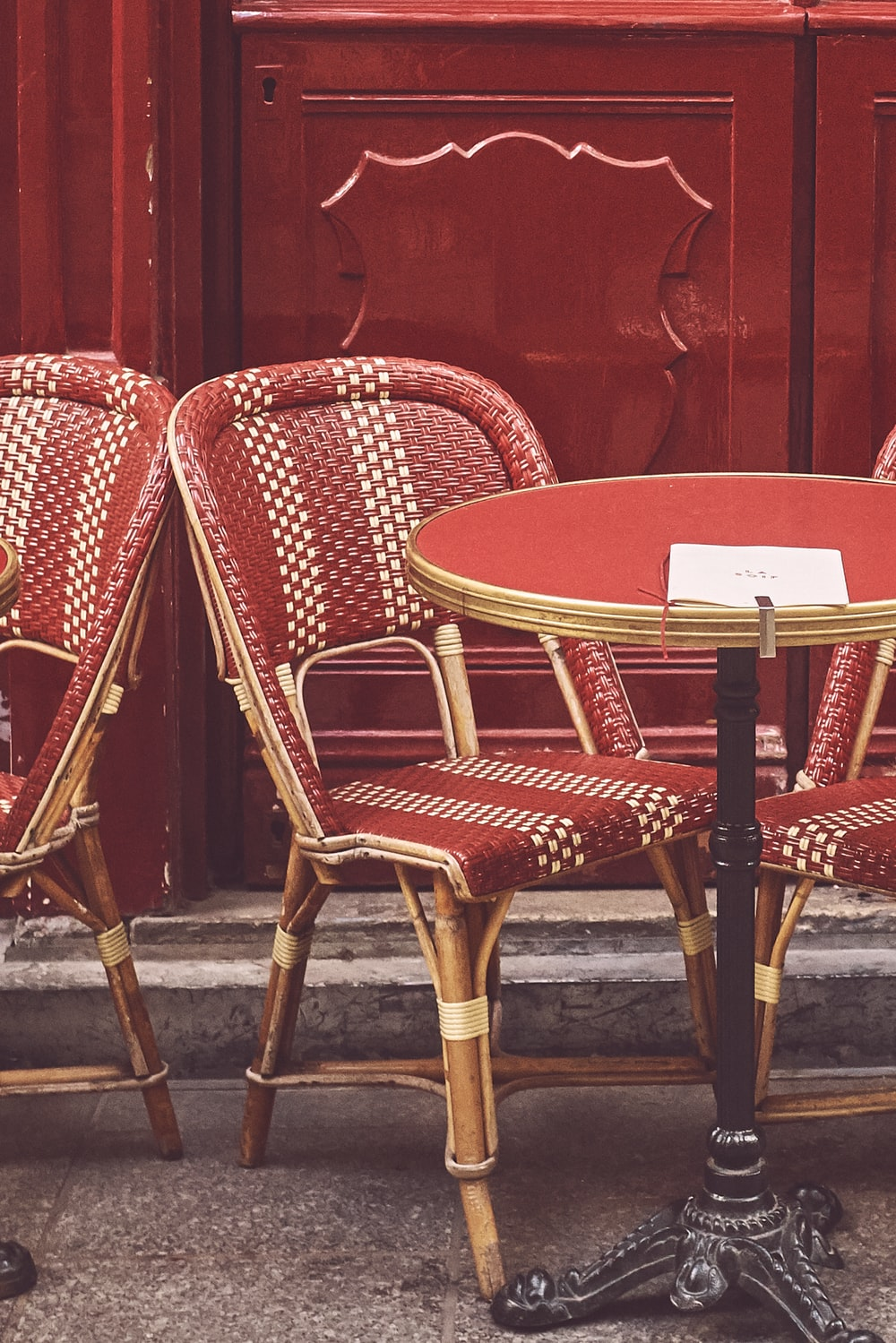red chairs near table