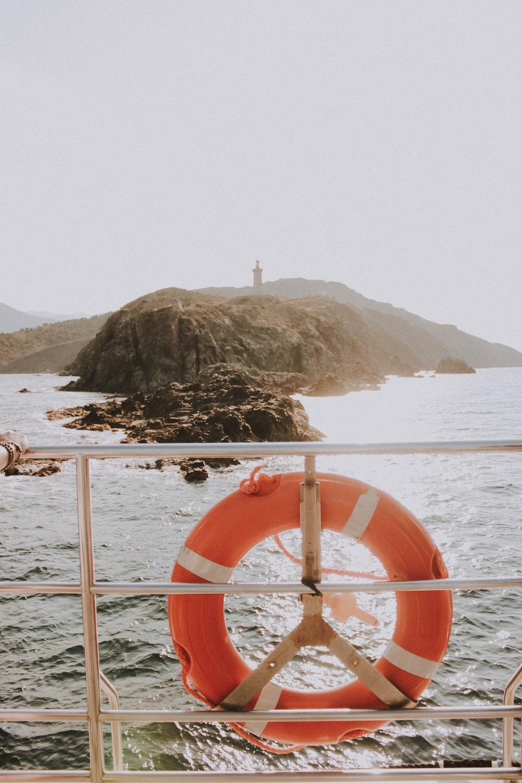 orange buoy on ship