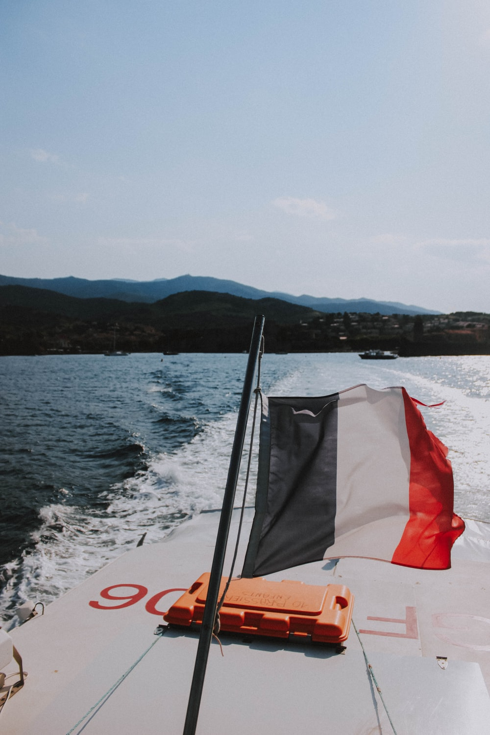 white and red flag on boat