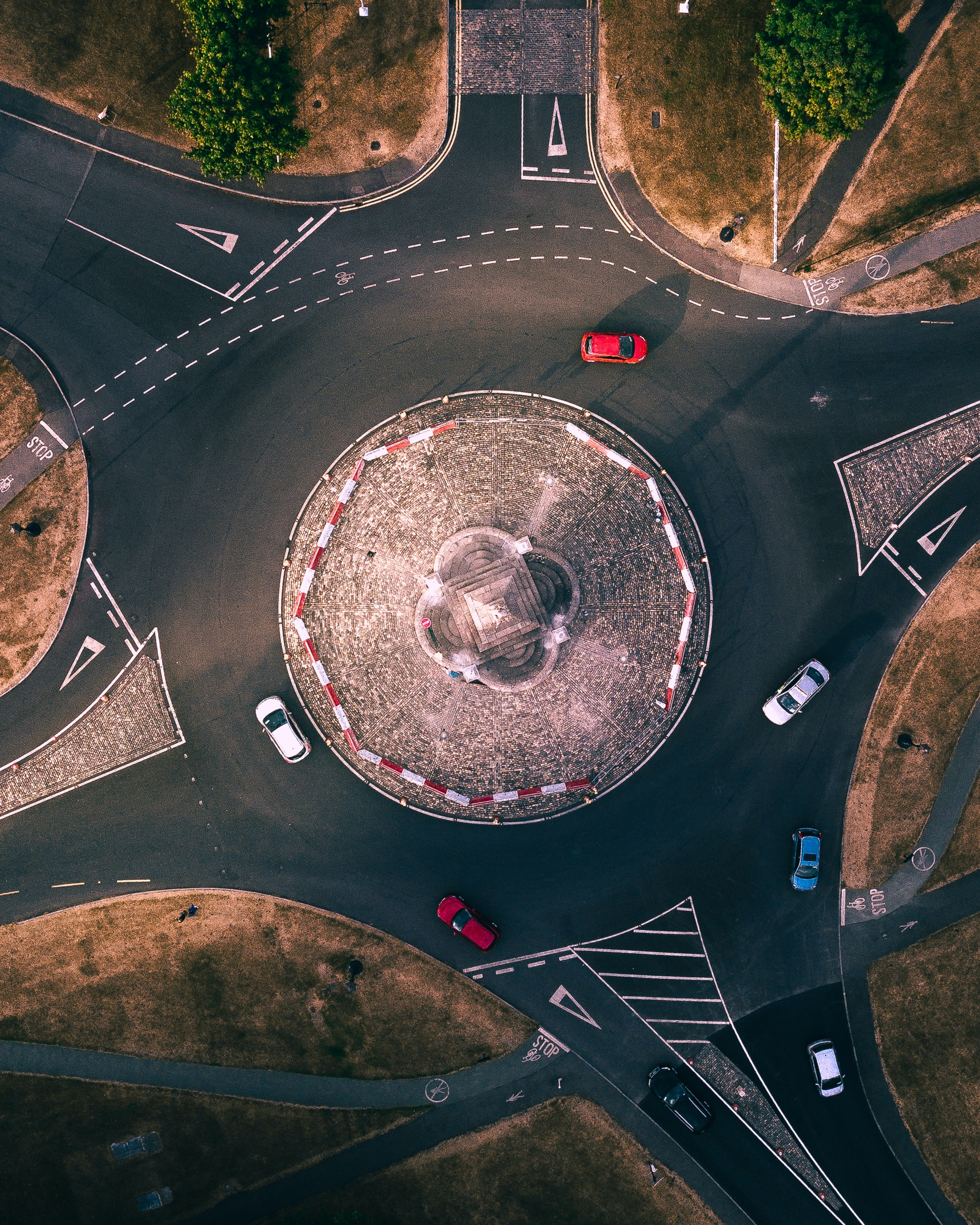 aerial view photography of red and white car on roundabout