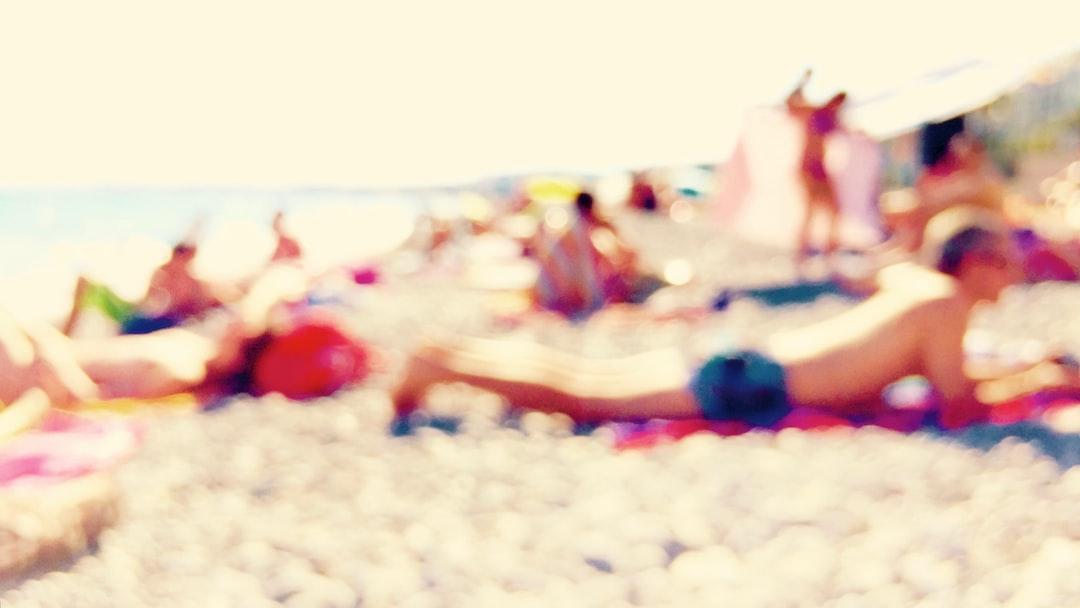 Sunbathing mood on the beach, Nice, France