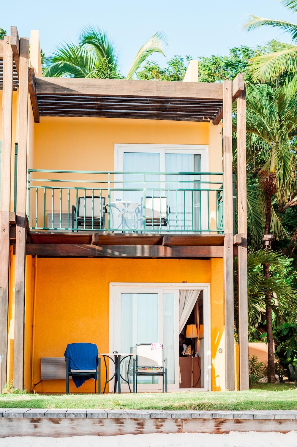 orange and white 2-storey building beside palm tree