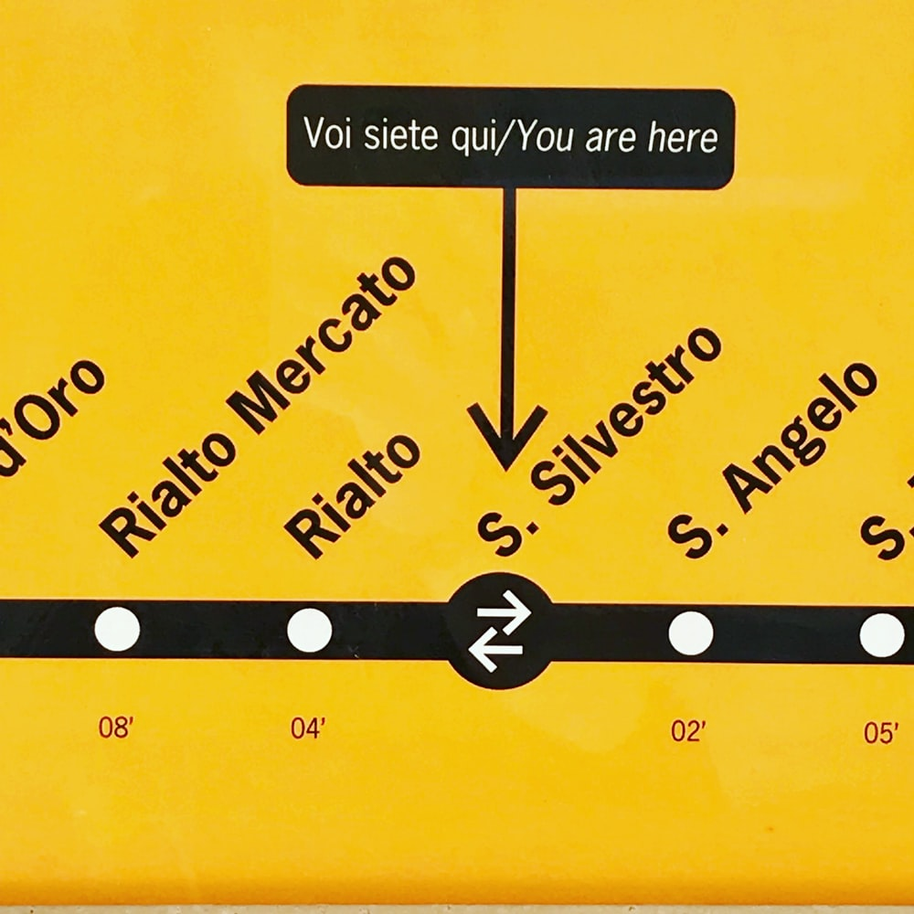 close shot of black and yellow station map