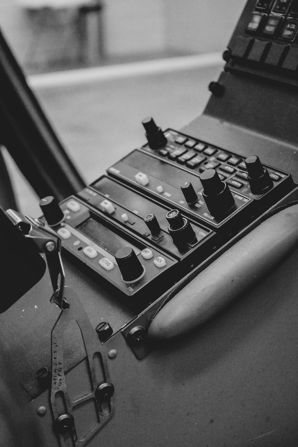 grayscale photography of vehicle control panel
