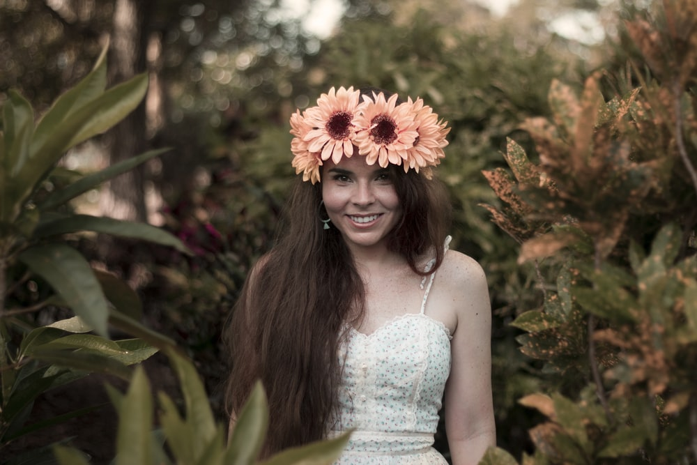 photo of woman in sunflower tiara during daytime