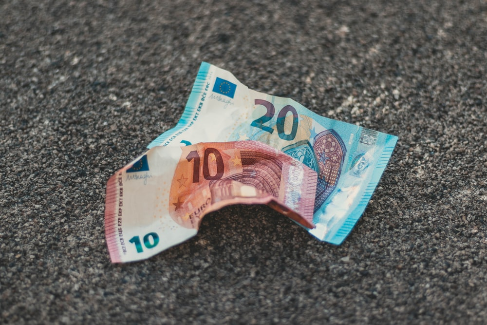 two 10 and 20 banknotes on floor