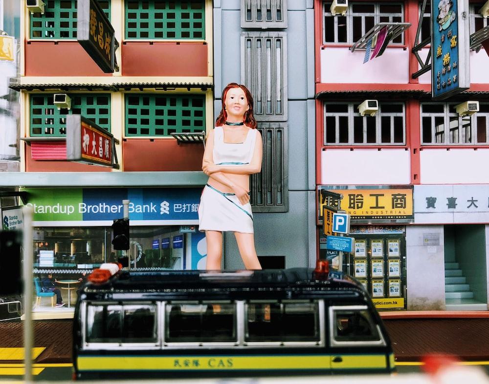 woman statue beside building
