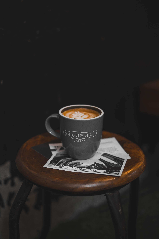 black coffee mug filed with espresso coffee