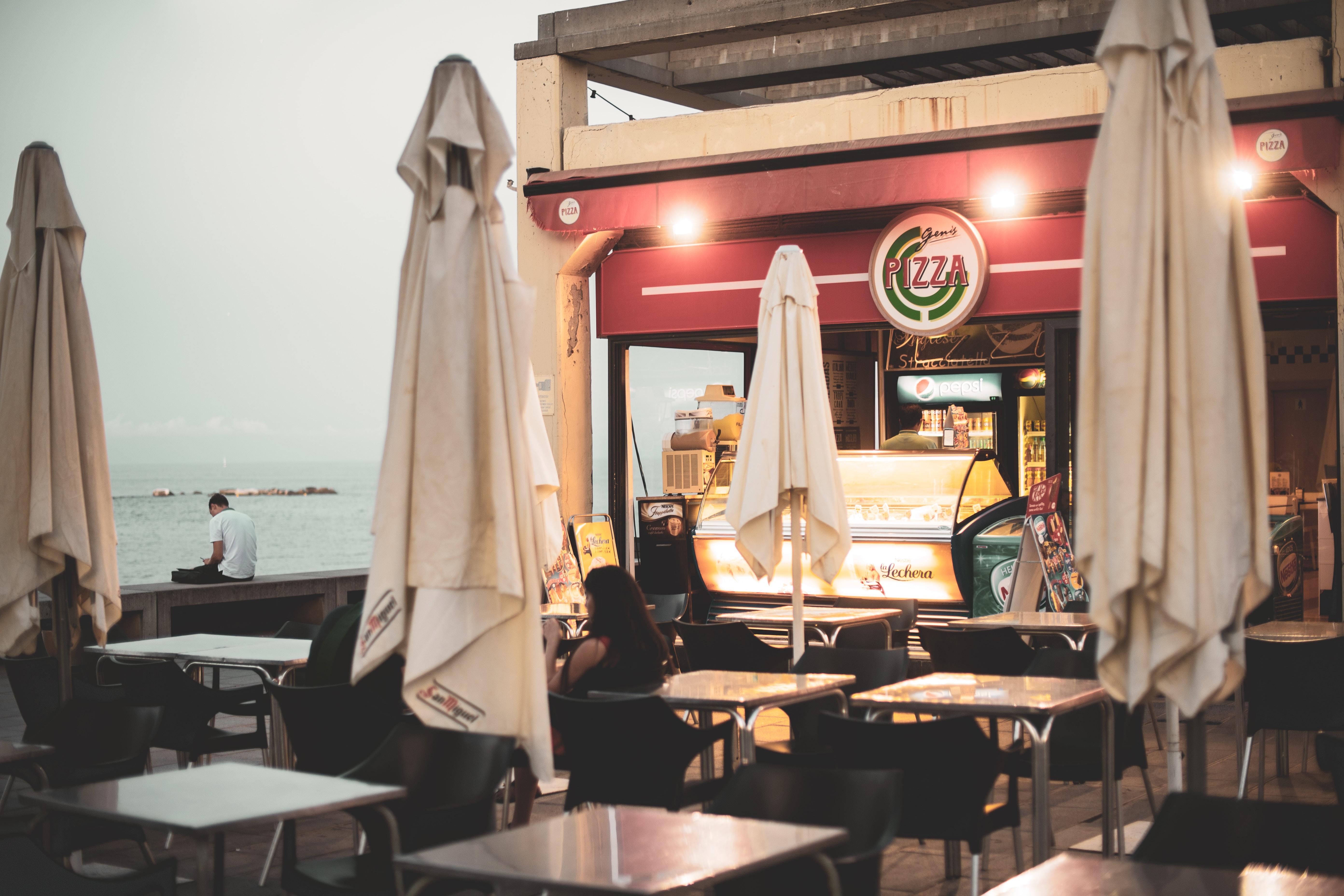white dining tables near food establishment
