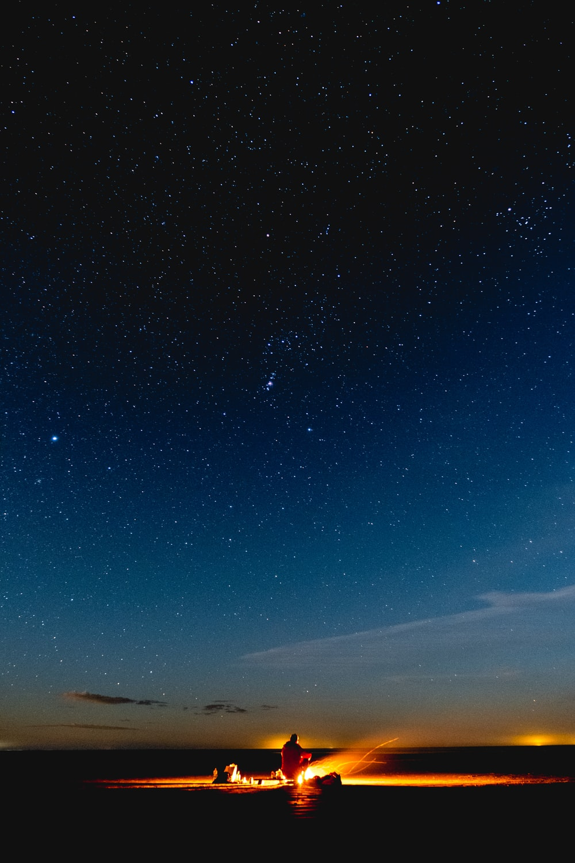person sitting under starry night