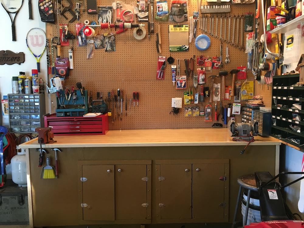 assorted hand tools near desk