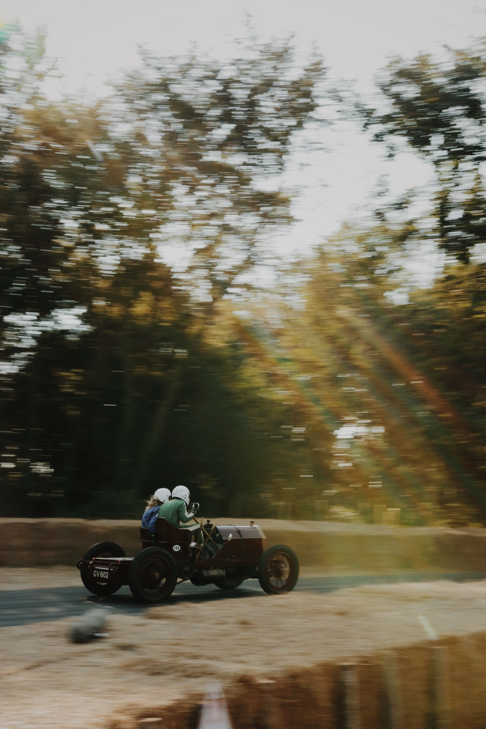 two person riding kart on roadway